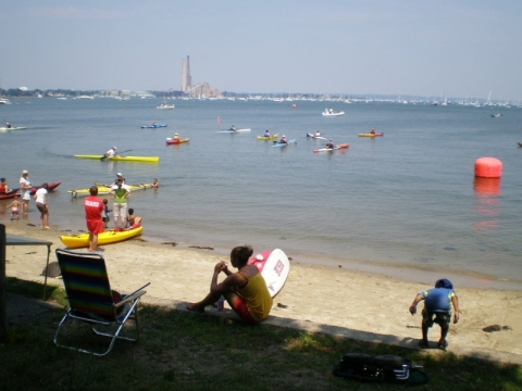 Salem Harber with kayaks and little boy diving in