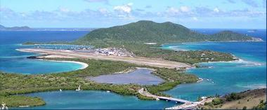 Beef Island with double lane bridge to Tortola in foregrown. Hans Creek Fisheries Protected Area is along right or west shore beyond airport. Photo credit: www.bareboatsbvi.com