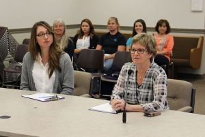 Former Newport Port Commission President Ginny Goblirsch (right), accompanied by Fishermen's Wives member Jennifer Stevenson (left).